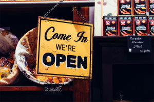 Help new business find customers with come in we're open sign.